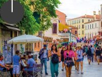 A city stroll through the lively Strada Nuova.