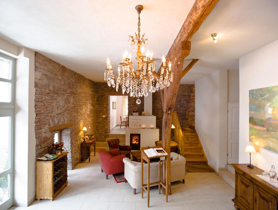 Visible elements: natural stone wall and wooden beams